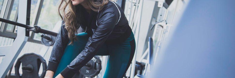 fitness woman tying shoe