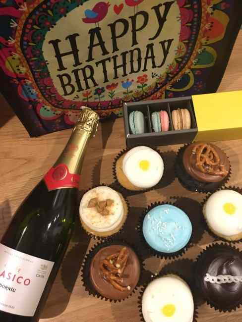 Getting the birthday party started right by brining gifts, cupcakes, macarons and champagne with us to our room at the Durham Hotel.