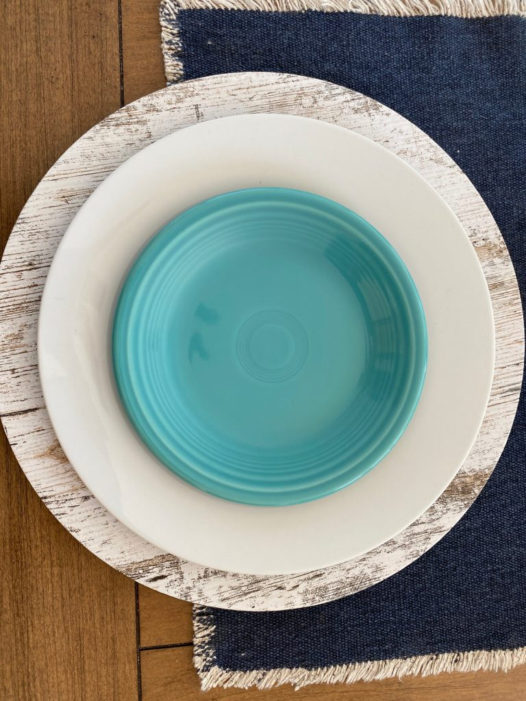 white plates layered with fiesta salad plate in turquoise