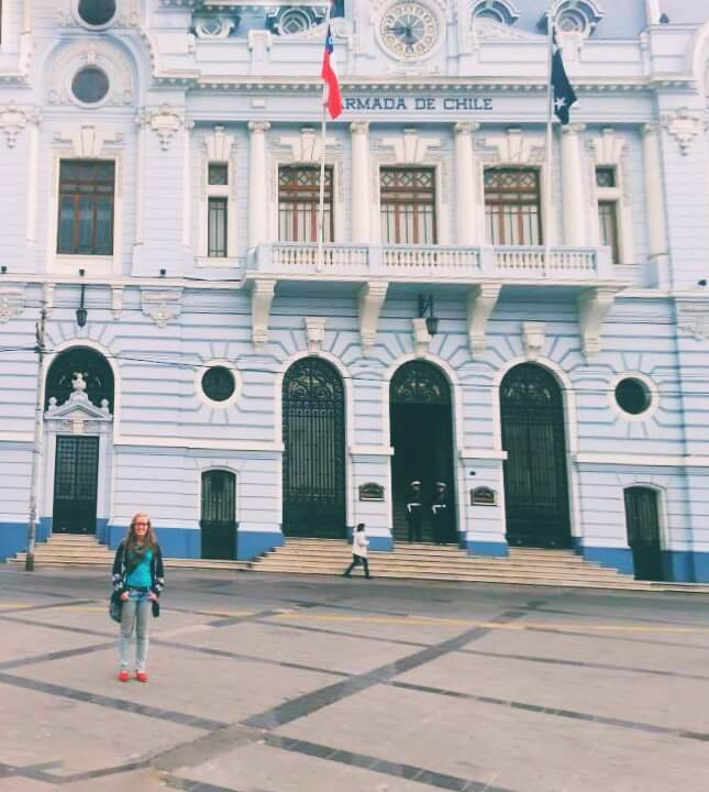Woman in front of government building, Valparaiso, Chile