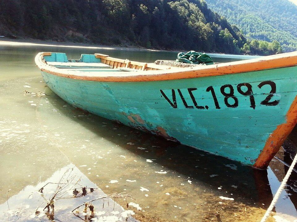 Turquoise boat on a lake
