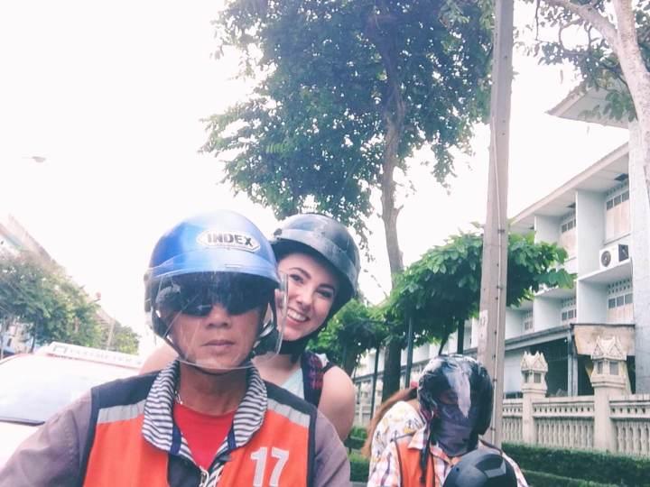 Girl riding a moto taxi