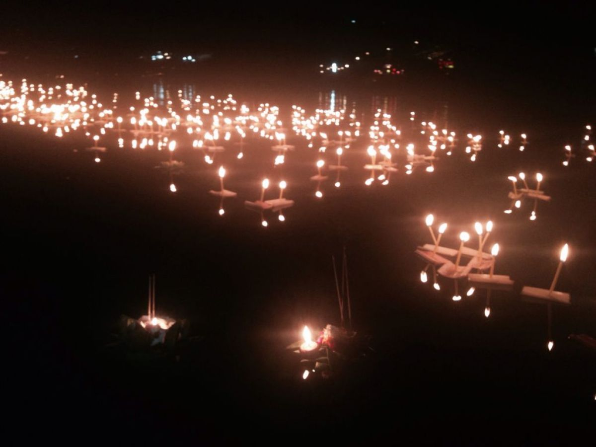floating lanterns on a river in Chiang Mai