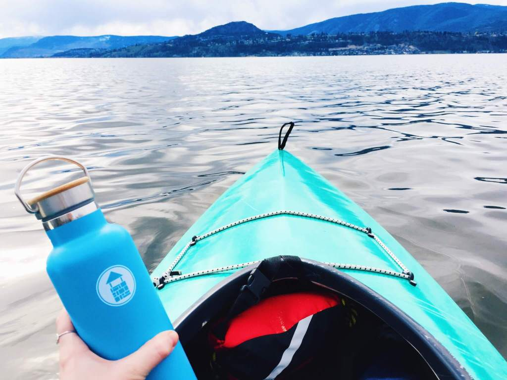 Reduce Your Ecological Footprint | Stainless steel water bottle in kayak