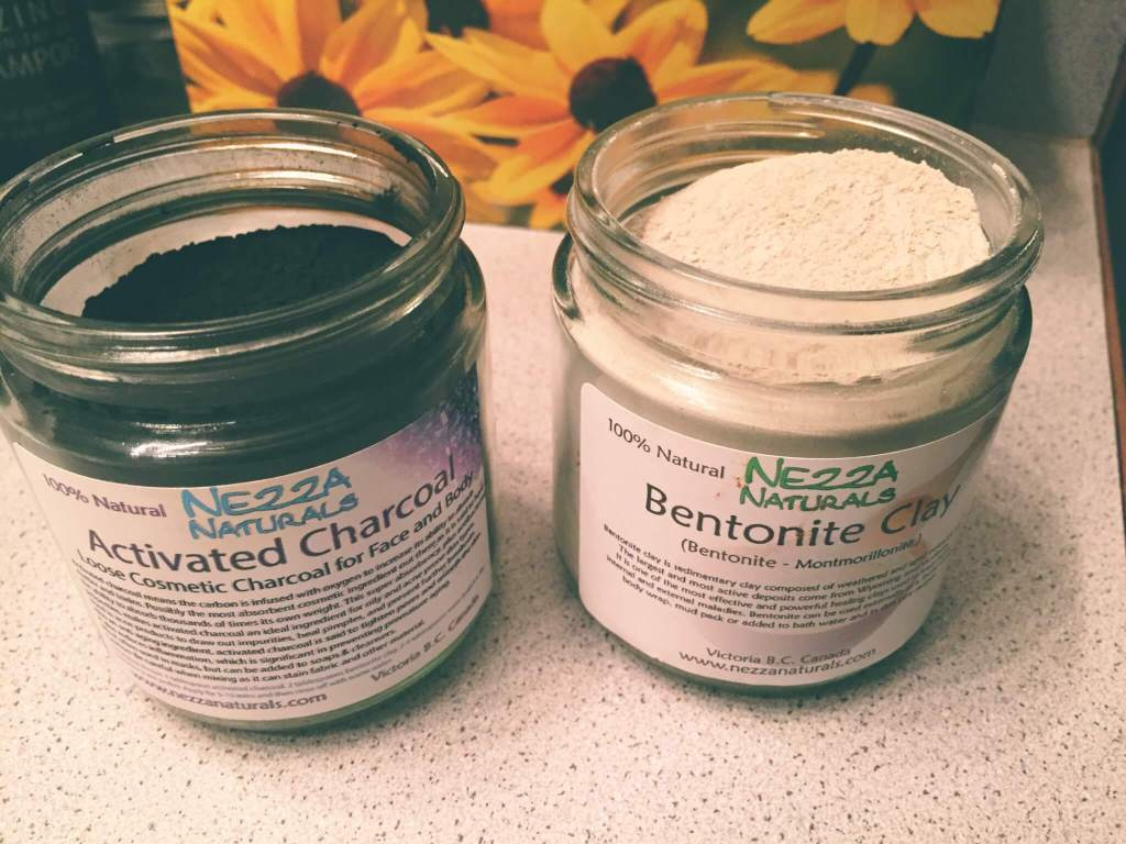 Activated Charcoal and Bentonite Clay Powders in Jars