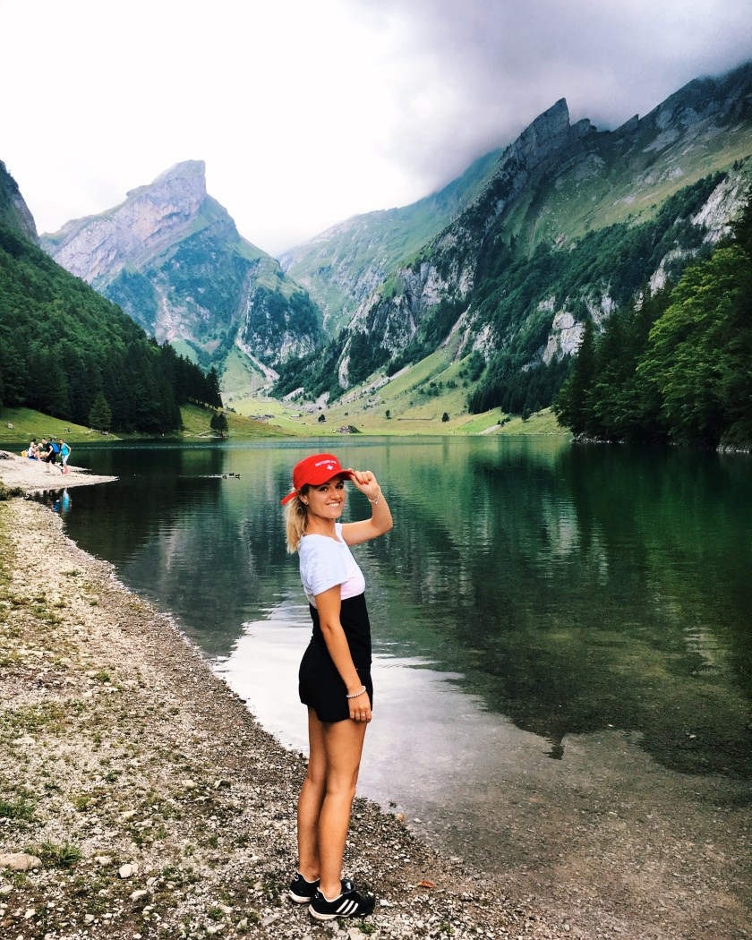 Standing in front of Seealpsee, in Appenzell, Switzerland
