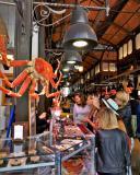 Beautiful women buying delicious appetizers / tapas at Mercado de San Miguel in Madrid, Spain.