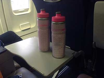 image of two pink pop top insulated travel water bottles