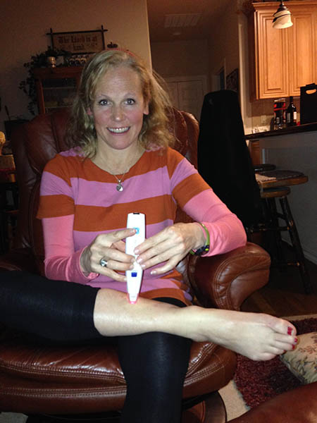 Image of Laura Coleman demonstrating cold laser therapy