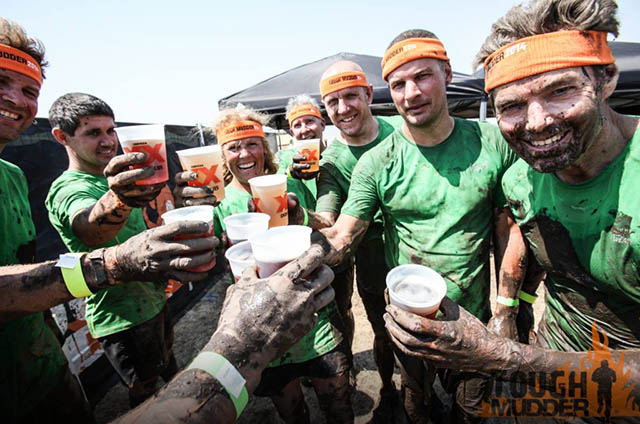 Image of Laura Coleman's Tough Mudder team celebrating with a beer