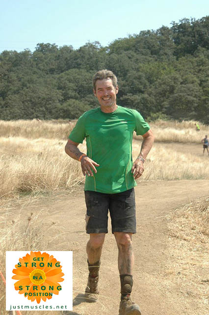 Image of Laura Coleman's Tough Mudder team leader running with knee pads around his ankles