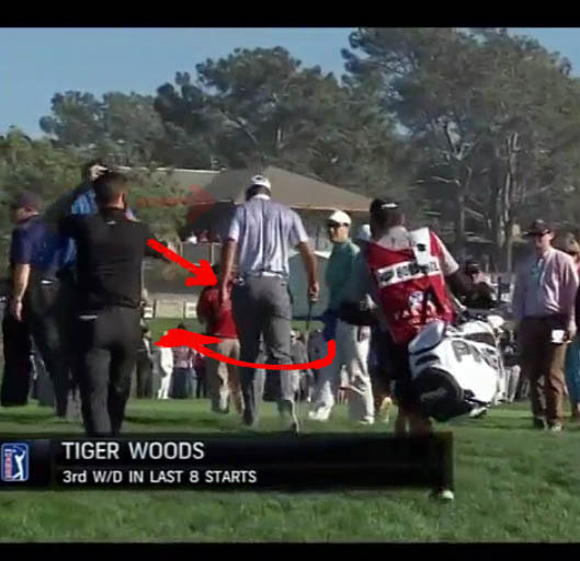 Image of Tiger Woods walking off golf course.