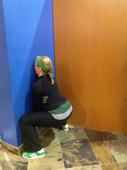 Image of Laura Coleman Demonstrating Sumo Squats against a wall start position