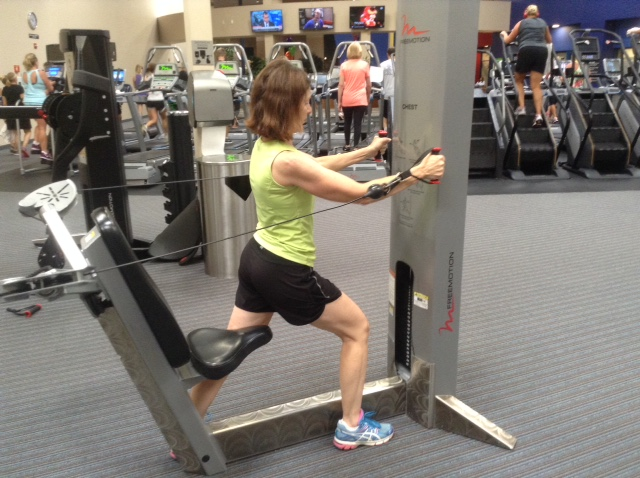 Image of woman in lunge position chest press