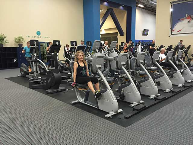 Image of a woman exercising on a stationary bike