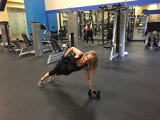 Image of woman doing renegade row exercise
