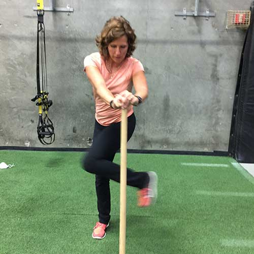Image of Connie Bear demonstrating a strength rotation golf exercise