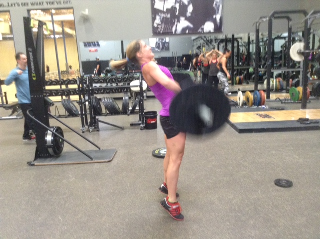 Image of woman doing olympic lift