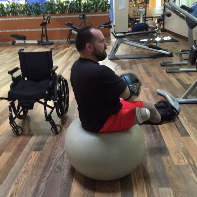 Image of man on balance ball