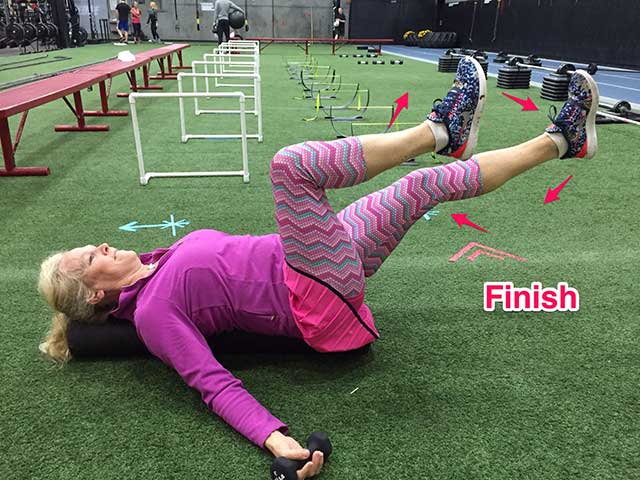 Image of Laura Coleman demonstrating air bike exercise for stomach and abs