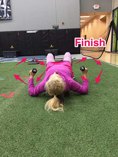 Image of Laura Coleman demonstrating helicopter exercise for stomach and abs finish