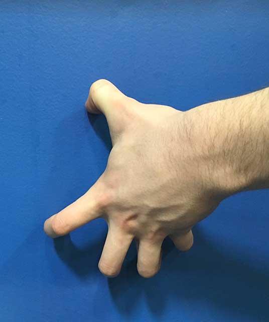 Image of hands in a Finger tip pushup hands yoga strengthening position