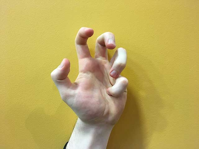 Image of hands in a pinkie fist hands yoga strengthening position