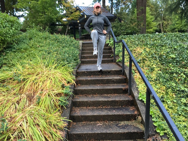 Image of woman doing stork walk exercise down steps