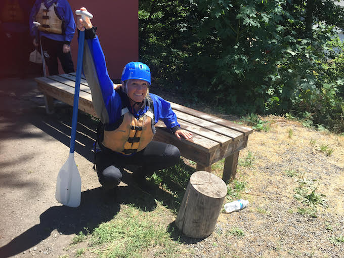 Image of personal trainer Laura Coleman demonstrating a stretch for warming up before white water rafting