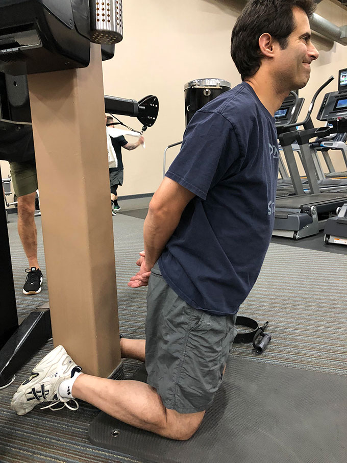 Image of a man doing a hamstring stretch exercise