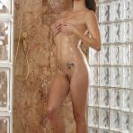 Third pic of Malena Morgan teases her pussy while taking the shower