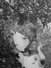 Mac, standing on Daddy's shoulders
