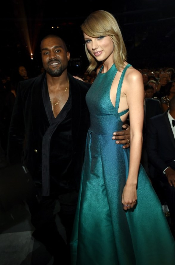 Taylor Swift and Kanye West buries the hatchet. Poses for a picture together
