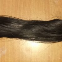 12 inches long and 2.5 inches thick light brown shiny virgin hair , poker straight and silky hairs