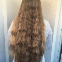 16-20 inches of honey blond virgin hair