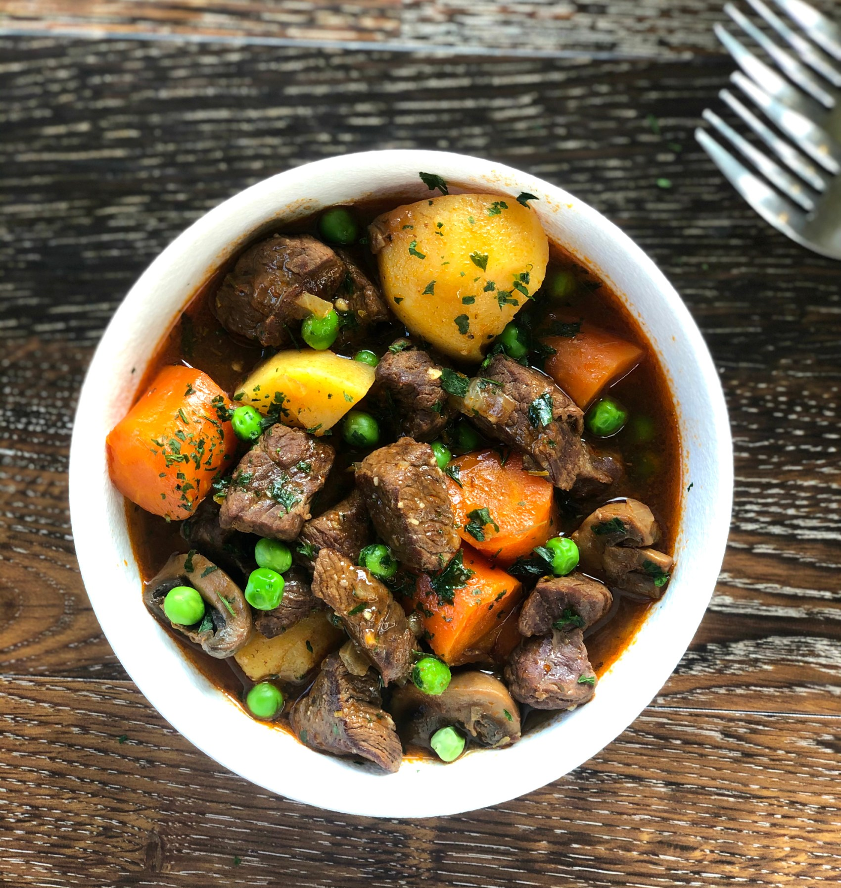 Bowl of one pot beef stew with vegetables