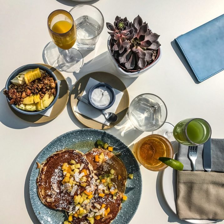 BRUNCH AT KOST - COCONUT PANCAKES, FRESH PRESSED JUICE, AND ACAI SMOOTHIE BOWL