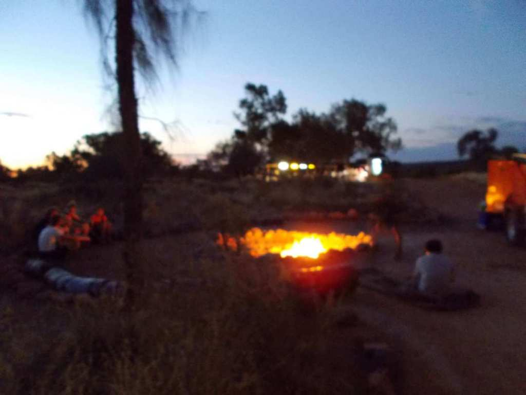 A camp fire in the middle of the Australian Outback