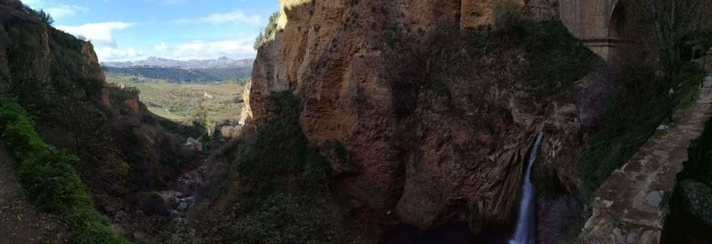 Looking through the gorge at the bottom of Ronda's Puente Nuevo bridge