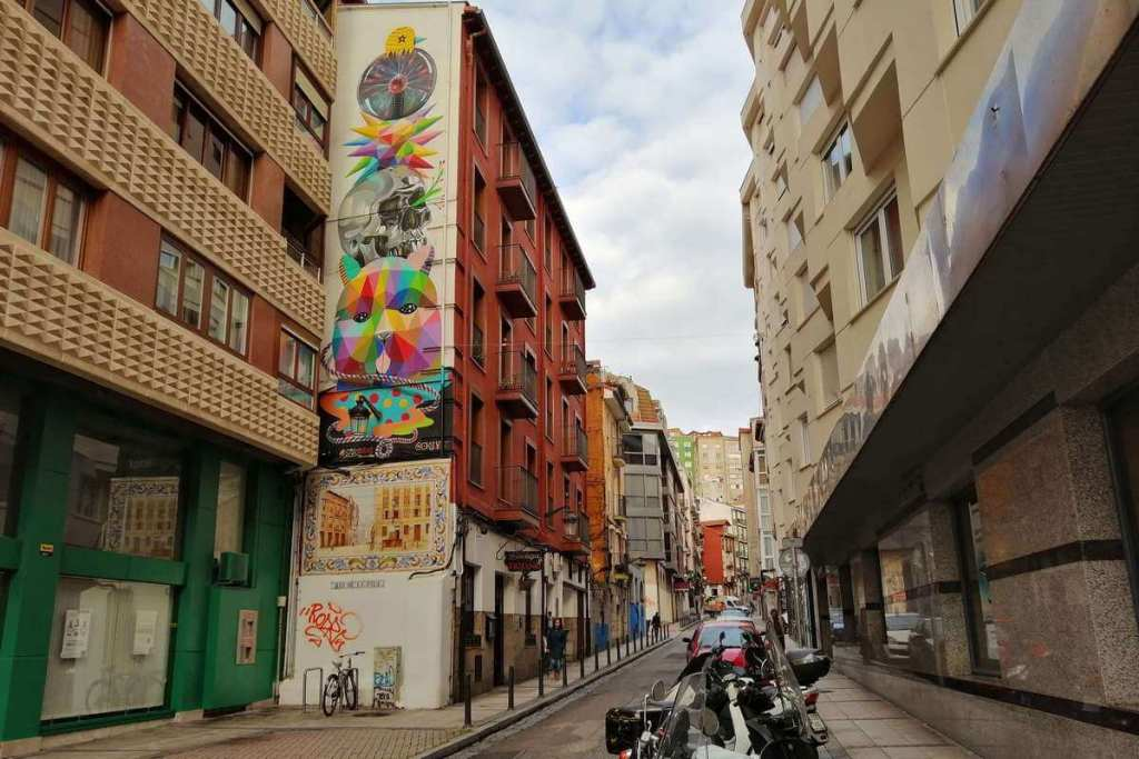 Street art by Okuda San Miguel in Santander