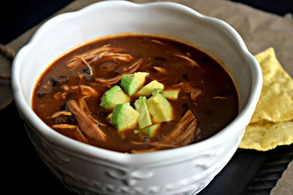 Enchiladas are one of my favorite meals ever! I think one of the biggest reasons is because of the enchilada sauce. I could eat it by the spoonful! So imagine how excited I was to come across the idea of enchilada soup. I get to eat enchilada sauce by the spoonful and not have my husband look at me strange!