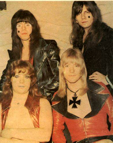 The Sweet like brickies in drag! Mr Priest is the one on the bottom left