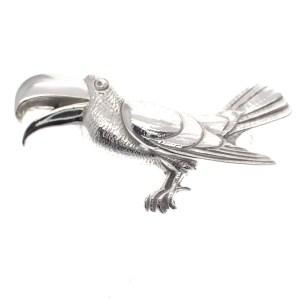 zilveren broche toekan vogel