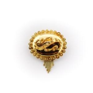 gouden s-broche