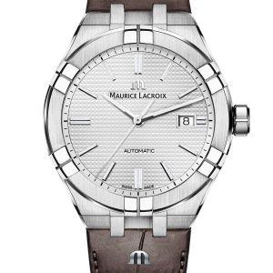 AIKON AUTOMATIC 42MM Schlichte Eleganz kommt nie aus der Mode – wie diese AIKON Automatic Date 42mm beweist. Das edle, braune Lederarmband in Kombination mit einem Edelstahlgehäuse und silbernem Zifferblatt mit «Clous de Paris»-Dekor macht diesen Chronographen zu einem wahren Kombinationswunder. Hierzu trägt auch das Schnellbandwechselsystem «Easy Change» bei, mit dem der Träger dieser Uhr in Sekundenschnelle das Armband seinen Vorlieben und Outfits anpassen kann. Mit Automatikwerk und Datumsanzeige weiß dieses Modell nicht nur durch seine Optik, sondern auch durch seine inneren Werte zu überzeugen.