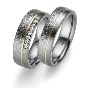 Tantalum Partnerringe TA-13 und TA-14 jetzt online entdecken. Trauringe in Tantal 999, komplett in Handarbeit hergestellt. Damenring mit 7 Diamanten im Brillantschliff.