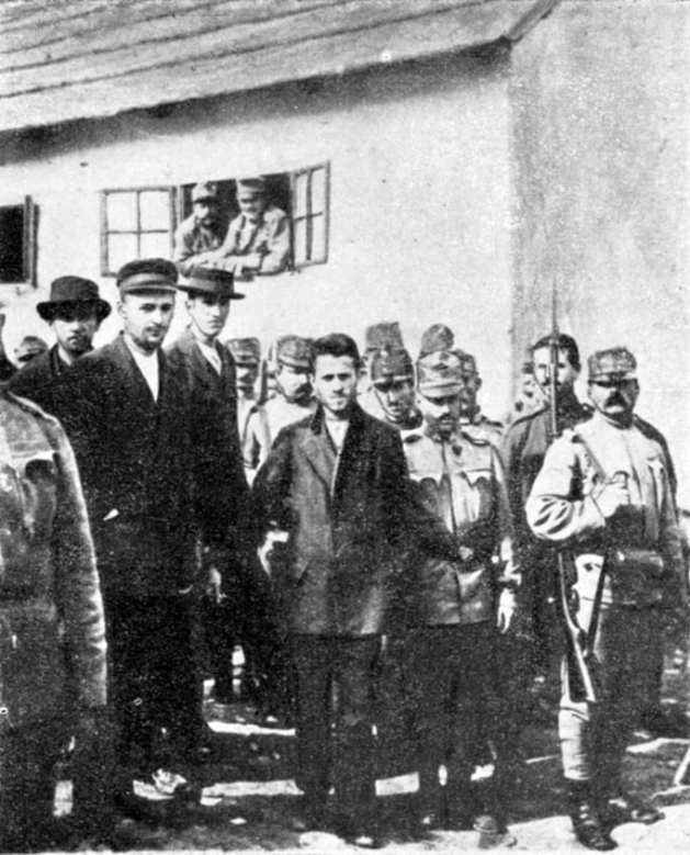 Gavrilo Princip being taken to court by Austro-Hungarian Soldiers