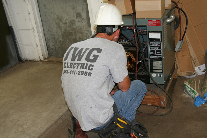 A residential electrician working on a furnace upgrade in Chester, NJ
