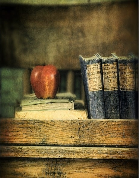 apple-and-books-on-the-teachers-desk-jill-battaglia