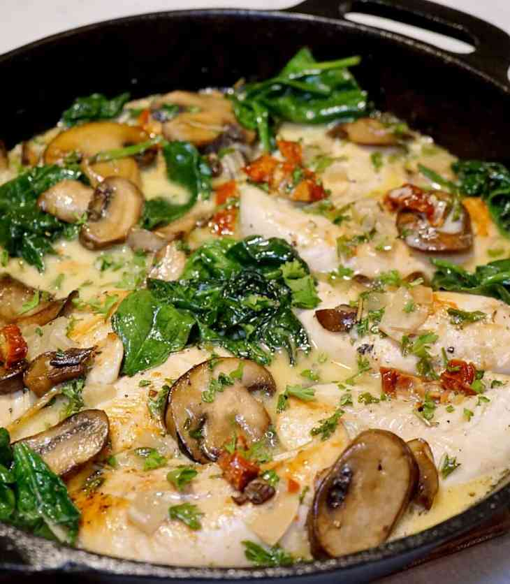 This is the only one pan skillet chicken recipe you need. It's made with a creamy mushroom sauce, sun dried tomatoes, and spinach.